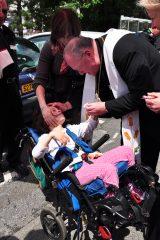 2011 Lourdes Pilgrimage - Archbishop Dolan with Malades (27/267)