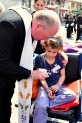 2011 Lourdes Pilgrimage - Archbishop Dolan with Malades (120/267)