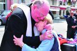 2011 Lourdes Pilgrimage - Archbishop Dolan with Malades (126/267)
