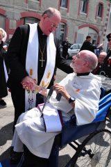 2011 Lourdes Pilgrimage - Archbishop Dolan with Malades (136/267)