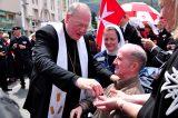 2011 Lourdes Pilgrimage - Archbishop Dolan with Malades (203/267)