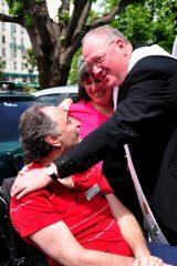 2011 Lourdes Pilgrimage - Archbishop Dolan with Malades (220/267)