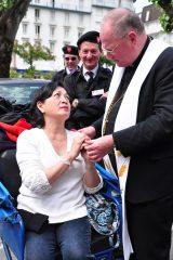 2011 Lourdes Pilgrimage - Archbishop Dolan with Malades (255/267)