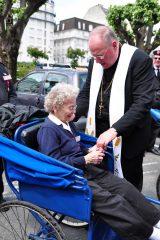 2011 Lourdes Pilgrimage - Archbishop Dolan with Malades (261/267)