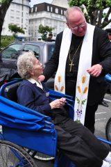 2011 Lourdes Pilgrimage - Archbishop Dolan with Malades (262/267)