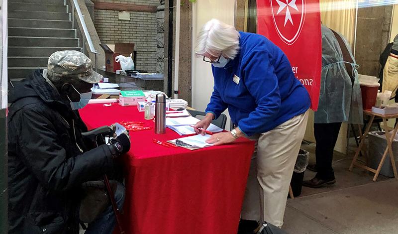 Pat Kingas, RN doing flu vaccine screenings